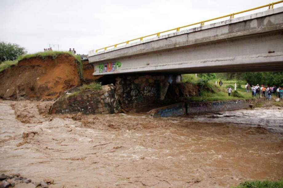 A badly damaged bridge near the town of Tlacolula delayed rescuers trying to reach Santa Maria de Tlahuitoltepec, and bad weather kept helicopters grounded.