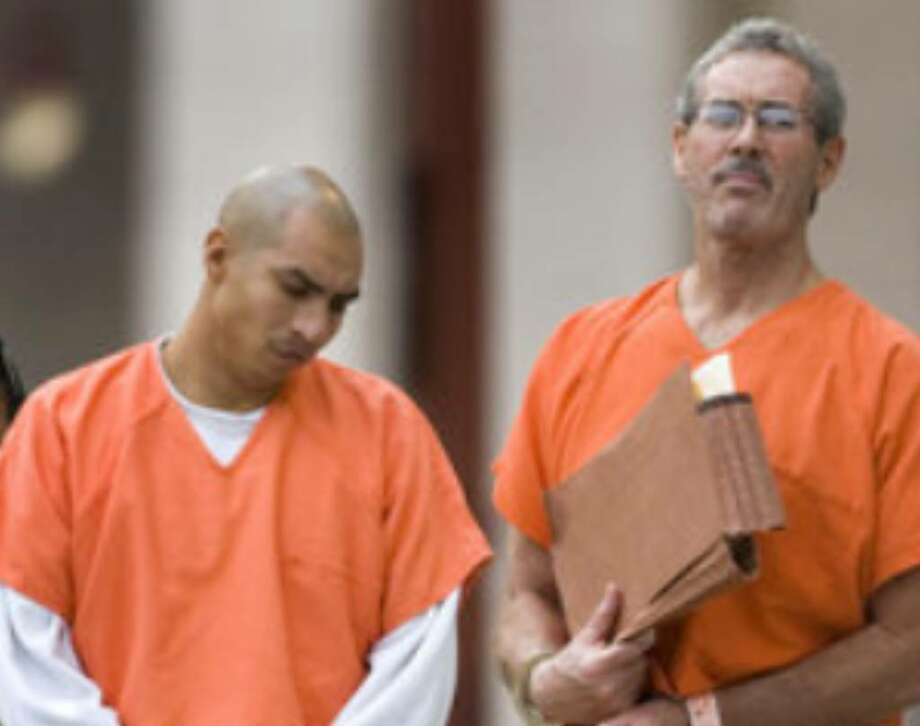 R. Allen Stanford (right) arrives at the federal courthouse in Houston to learn who will defend him.
