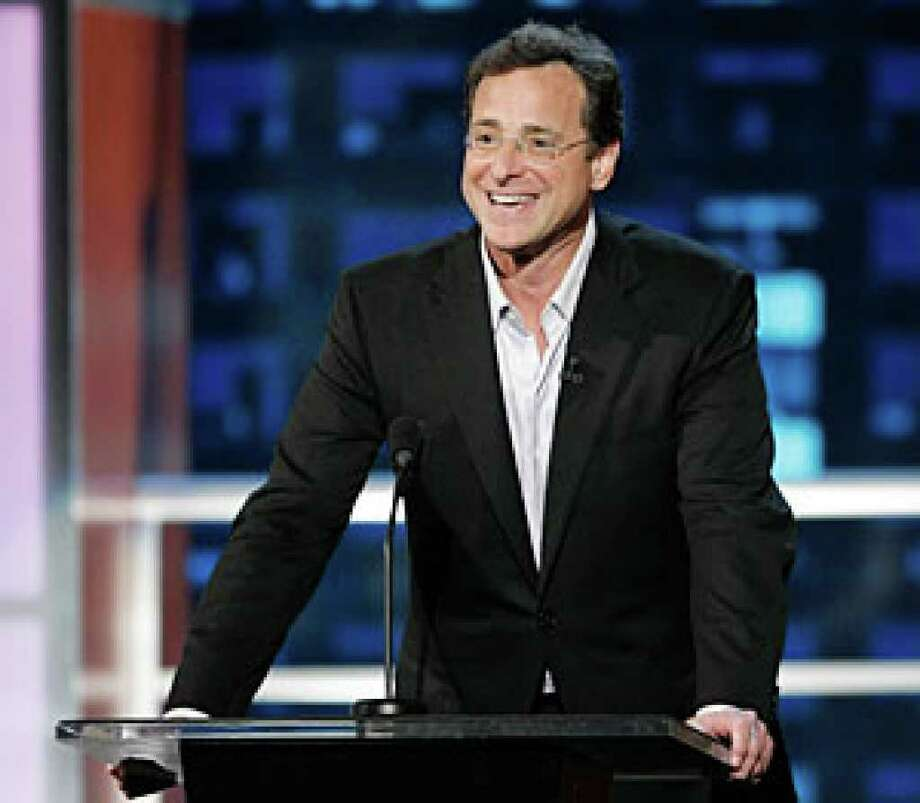 "In this file photo Bob Saget speaks at the ""Comedy Central Roast of Bob Saget"" in Burbank, Calif."