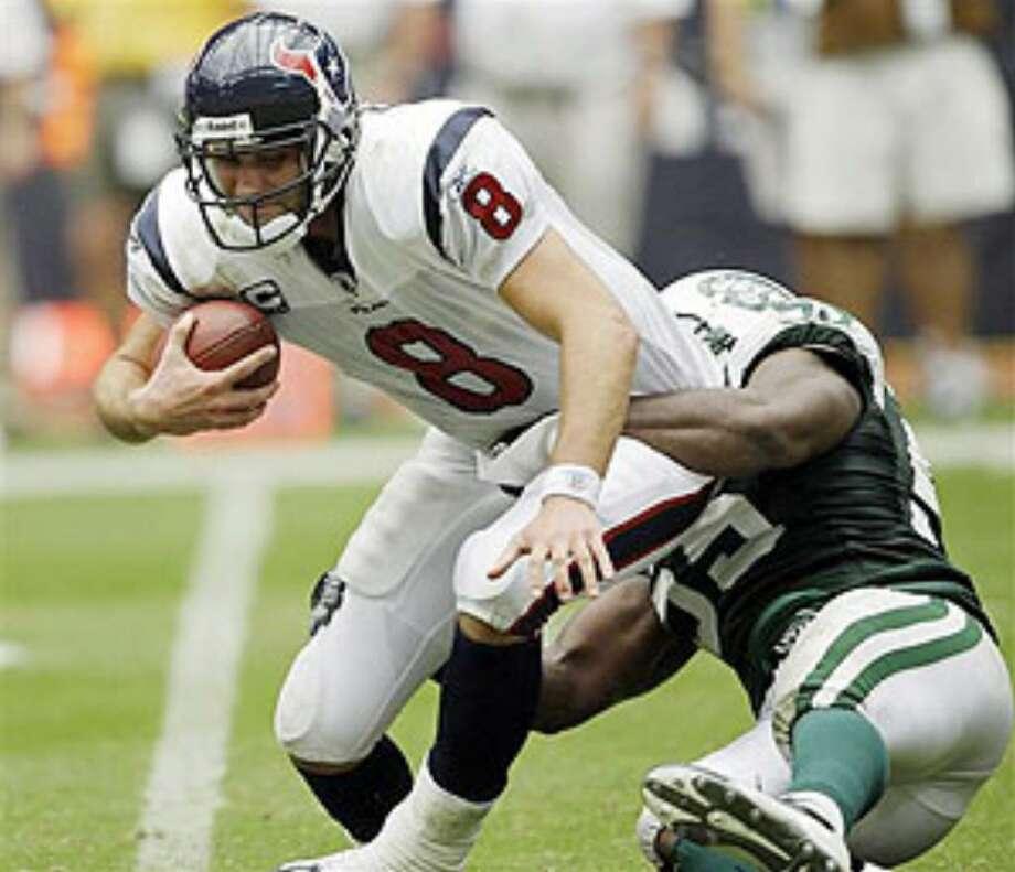Texans quarterback Matt Schaub is sacked by the Jets' Jamaal Westerman.