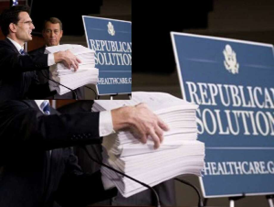 House Minority Leader John Boehner of Ohio (right) looks on as House Minority Whip Eric Cantor of Virginia speaks on Capitol Hill in Washington Oct. 29, while holding a copy of the Democrat's version of the health care bill.