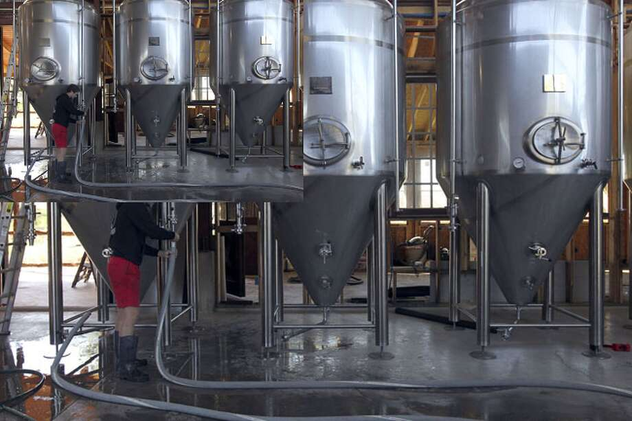 Co-founder Michael Stuffings works with fermentation tanks at the Jester King Craft Brewery in the Texas Hill Country.