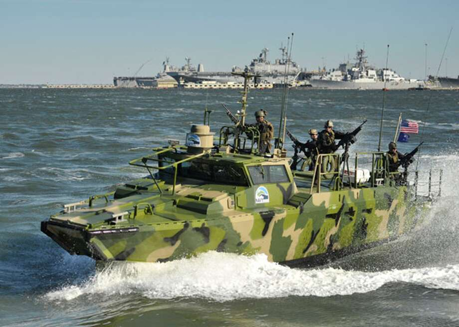 Sailors assigned to Riverine Group 1 conduct maneuvers aboard Riverine Command Boat (Experimental) (RCB-X) at Naval Station Norfolk, Va., on Oct. 22. The RCB-X is powered by an alternative fuel blend of 50 percent algae-based and 50 percent NATO F-76 fuels to reduce total energy consumption on naval ships.