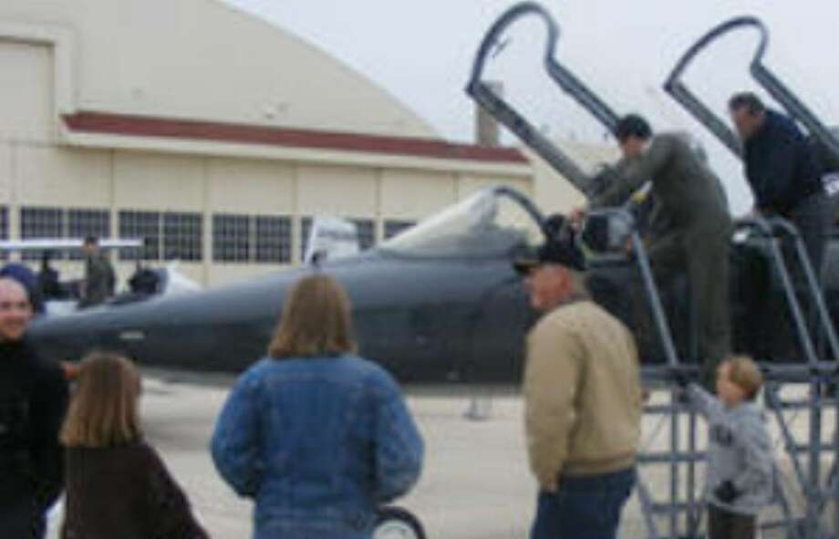 "Attendees to Saturday's Randolph AFB ""Civilian Fly-In"" get a good look inside one of the base's static displays."