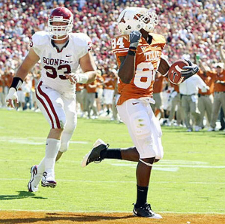 Texas' Marquise Goodwin celebrates as he scores a second-half touchdown ahead of Oklahoma's Auston English.