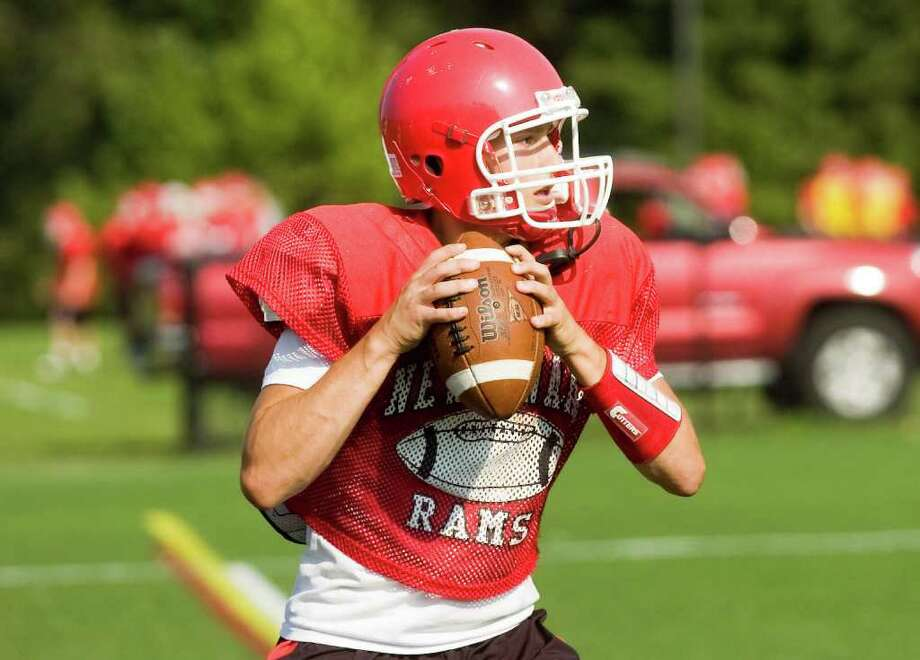New Canaan quarterback Matt Milano in action as the team practices at the school Thursday, September 1, 2010. Photo: Keelin Daly, ST / Stamford Advocate