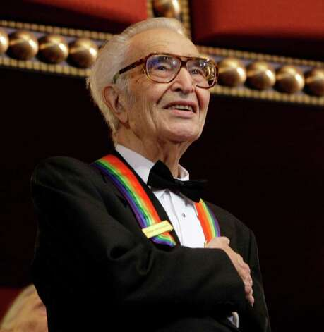 "FILE - In this Dec. 6, 2009 file photo, Kennedy Center honoree Dave Brubeck stands for the National Anthem at the Kennedy Center Honors gala in Washington. Brubeck, who turns 90 on Monday, Dec. 6, 2010, will celebrate the day by gathering in the family home in the Connecticut woods to watch Turner Classic Movies broadcast ""Dave Brubeck: In His Own Sweet Way,"" a new documentary directed by Bruce Ricker, produced by Clint Eastwood and narrated by Alec Baldwin. (AP Photo/Alex Brandon, File) Photo: Alex Brandon, AP / AP2009"