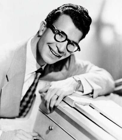 "FILE - This 1956 file photo shows Dave Brubeck, American composer, pianist and jazz musician. Brubeck, who turns 90 on Monday, Dec. 6, 2010, will celebrate the day by gathering in the family home in the Connecticut woods to watch Turner Classic Movies broadcast ""Dave Brubeck: In His Own Sweet Way,"" a new documentary directed by Bruce Ricker, produced by Clint Eastwood and narrated by Alec Baldwin. (AP Photo/File) Photo: AP / AP1956"