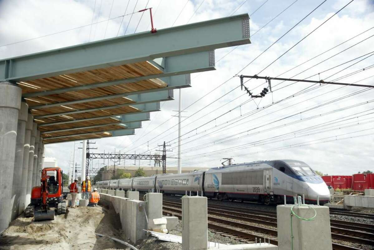 The Amtrak Acela train rolls through the construction site for the new Fairfield Metro North Station, in Fairfield, Thursday, Sept. 10, 2009.
