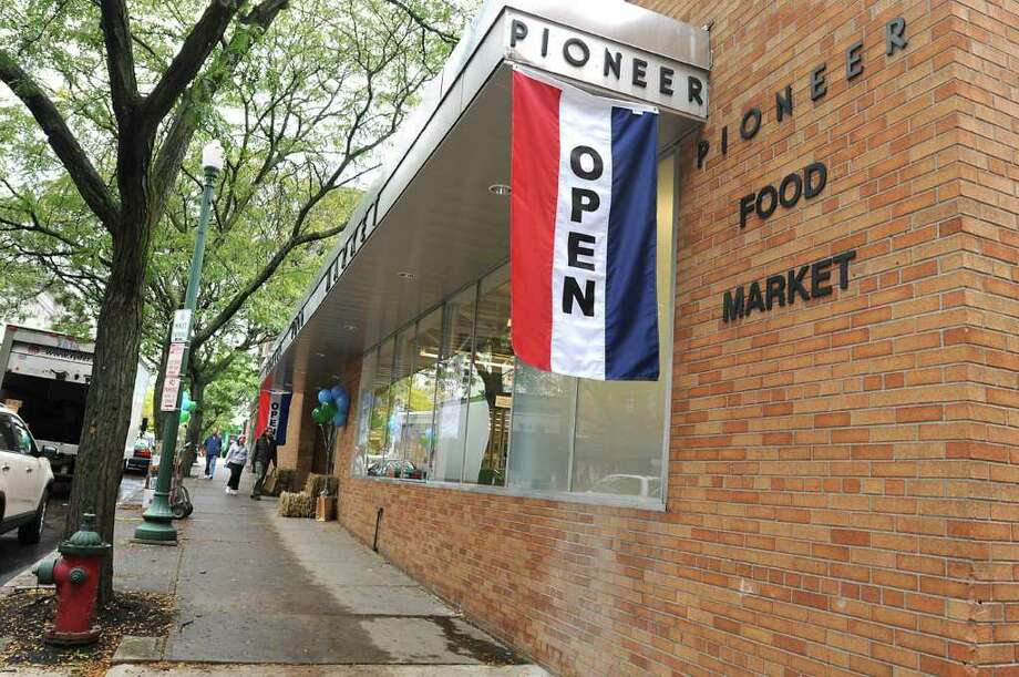 People enter the Pioneer Food Market in Troy, NY on October 5, 2010. The food co-op opened today.  (Lori Van Buren / Times Union) Photo: Lori Van Buren / 00010546A