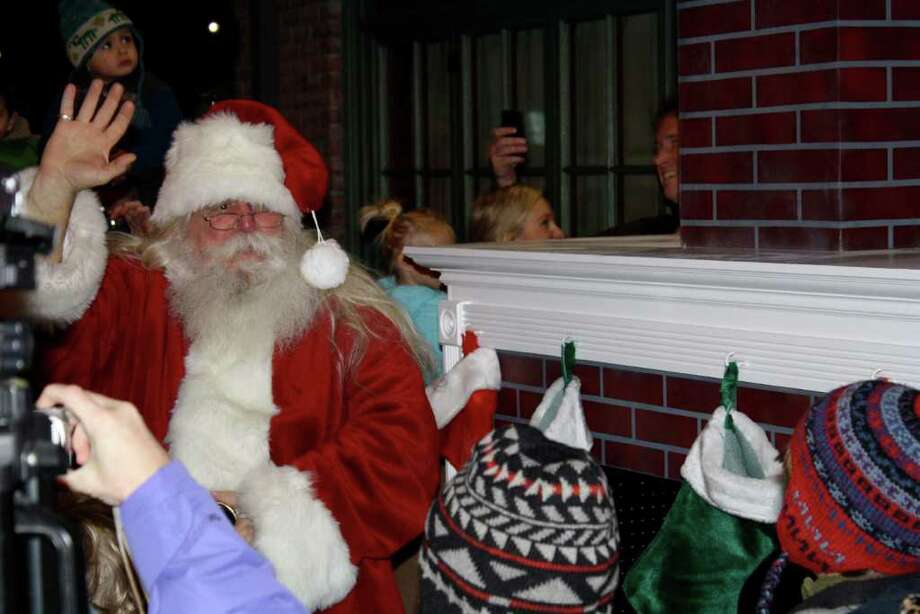 Santa arrives down the chimney during Darien's Holiday Magic event Saturday evening. 12-04-10 Photo: Ben Holbrook Staff Photo, Contributed Photo / Darien News