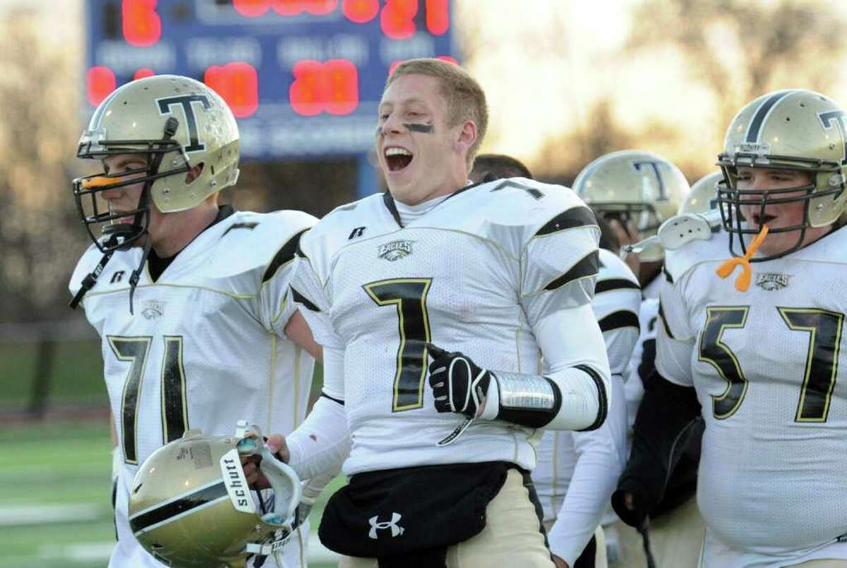 Highlights from Class LL semifinal football action between Norwich Free Academy and Trumbull in West Haven, Conn. on Saturday December 4, 2010. Trumbull beat Norwich 21-6. Trumbull QB Ian Milne, center, celebrates the team's win over Norwich.
