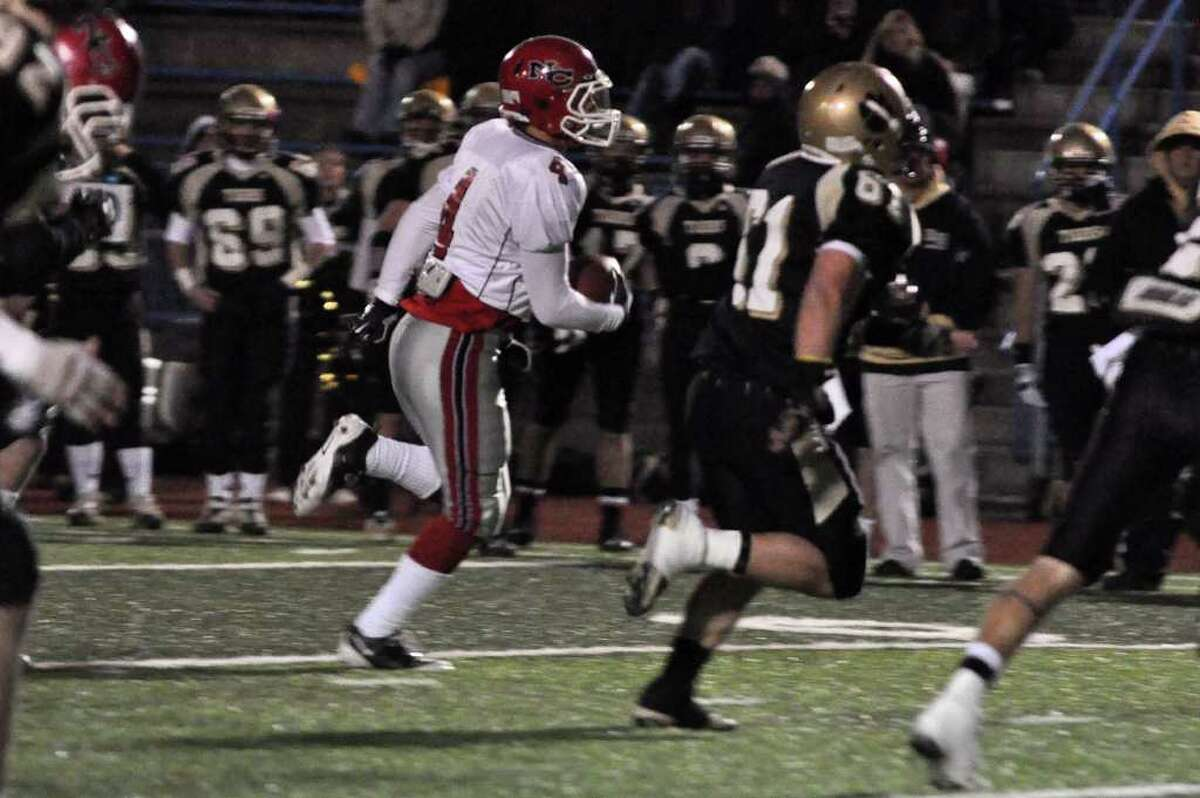 New Canaan's Kevin Macari (4) runs for a touchdown after intercepting Daniel Hand's ball during the CIAC Class L semifinals against Daniel Hand at Ken Strong Stadium in West Haven on Saturday, Dec. 4, 2010.