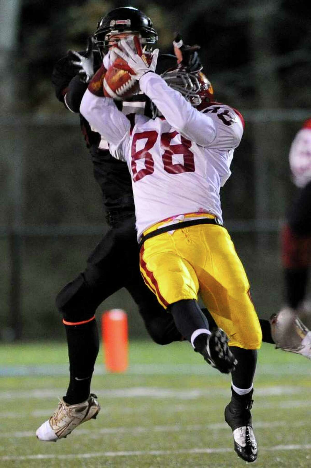 St. Joseph's Shane Miller intercepts a pass during Saturday's Class S semifinal game in Waterbury between St. Joseph and Valley Regional High Schools on December 4, 2010.