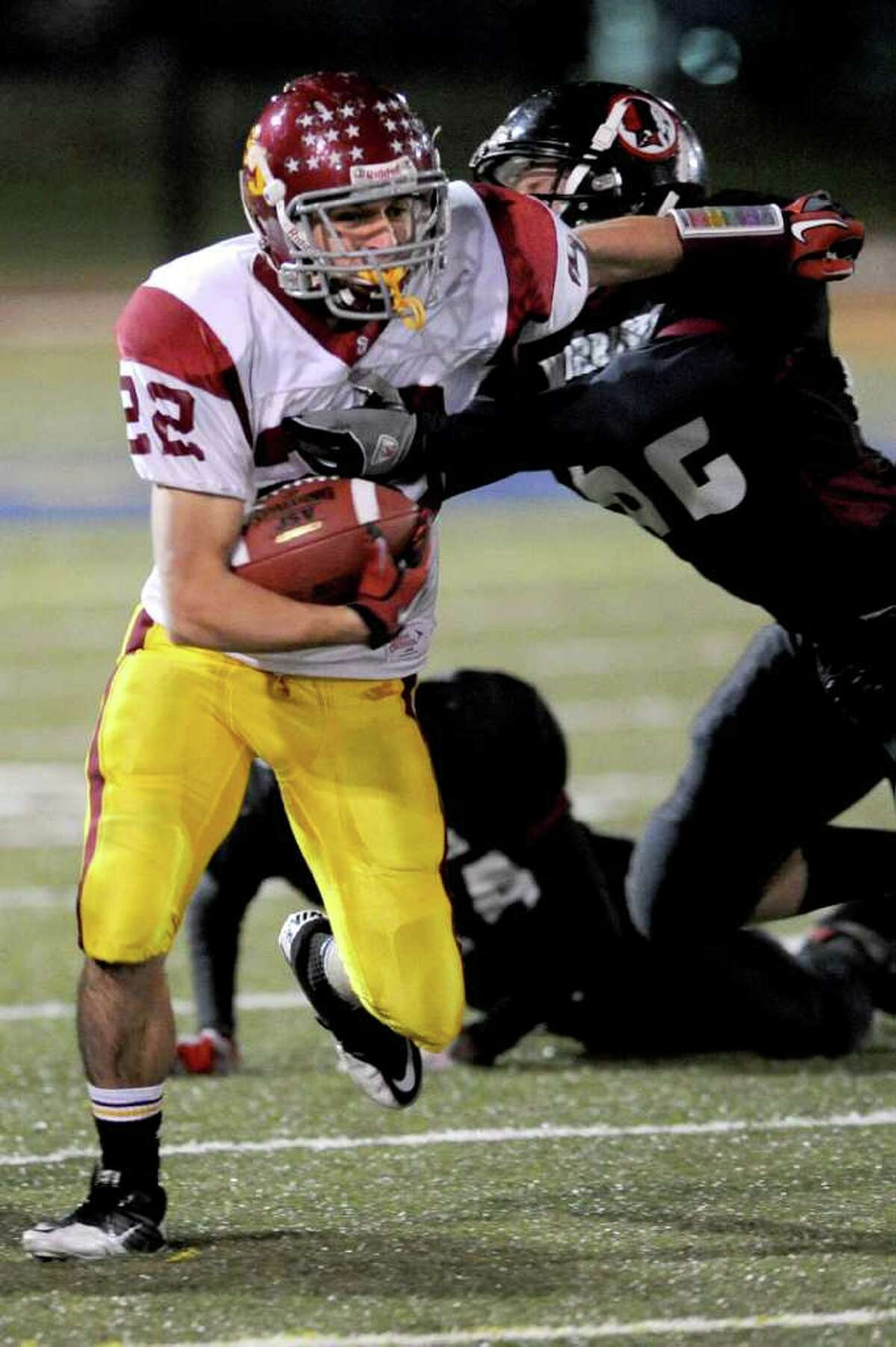 St. Joseph's Jerry Kramer carries the ball during Saturday's Class S semifinal game in Waterbury between St. Joseph and Valley Regional High Schools on December 4, 2010.