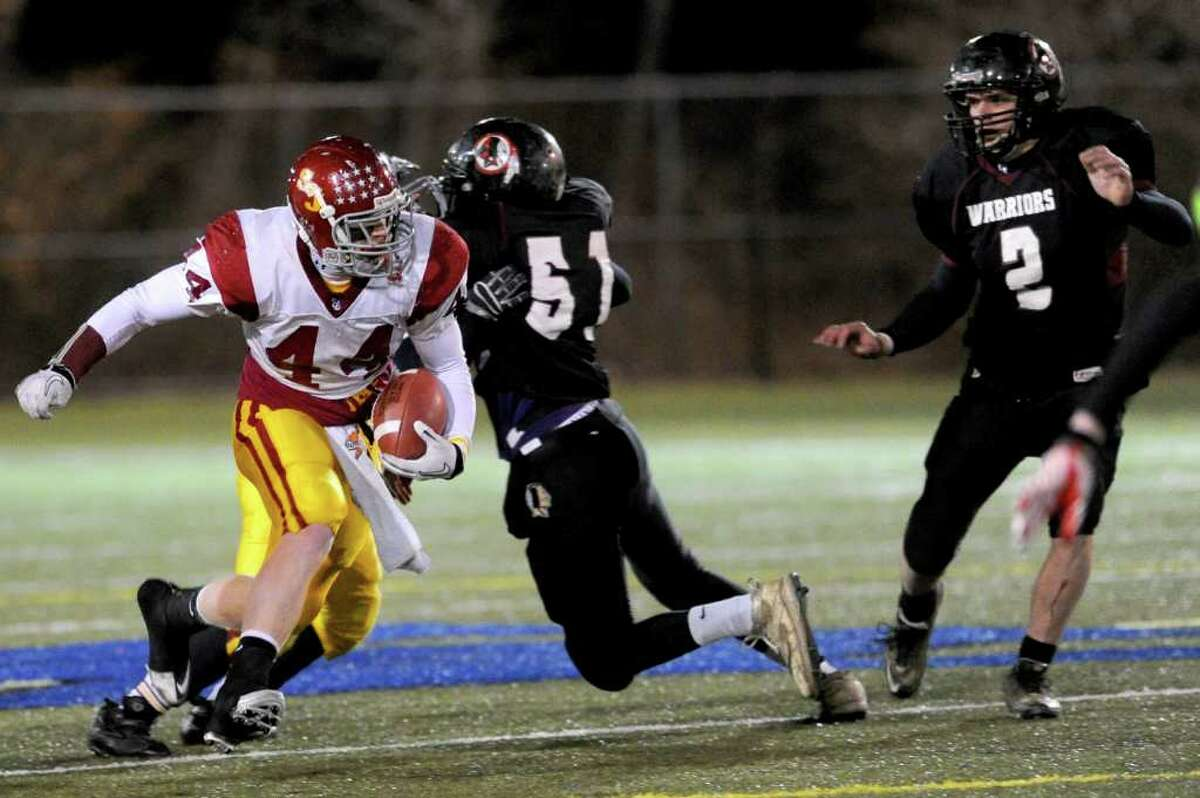 St. Joseph's Tyler Matakevich carries the ball during Saturday's Class S semifinal game in Waterbury between St. Joseph and Valley Regional High Schools on December 4, 2010.