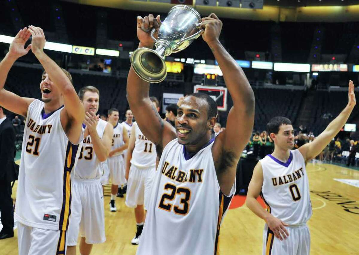 UAlbany's Tim Ambrose holds the Albany Cup after their win over Siena. (John Carl D'Annibale / Times Union)