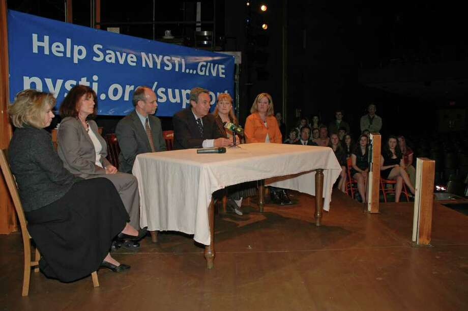 Assemblyman Ron Canestrari speaks out in support of the New York State Theatre Institute on Oct. 13, 2010, as NYSTI launches a fundraising and public-service appeal. He is joined, at his right, by David Bunce, interim producing artistic director of NYSTI, and from left to right Jane Cordts, first vice president and manager of government banking for First Niagara Bank and a member of NYSTI's Community Advisory Committee; Eileen Landy, statewide secretary of United University Professions; Susan Scrimshaw, president of the Sage Colleges, and Erin Wallace, teacher, NYSTI parent and member of NYSTI's Community Advisory Committee. (Photo by John Romeo)