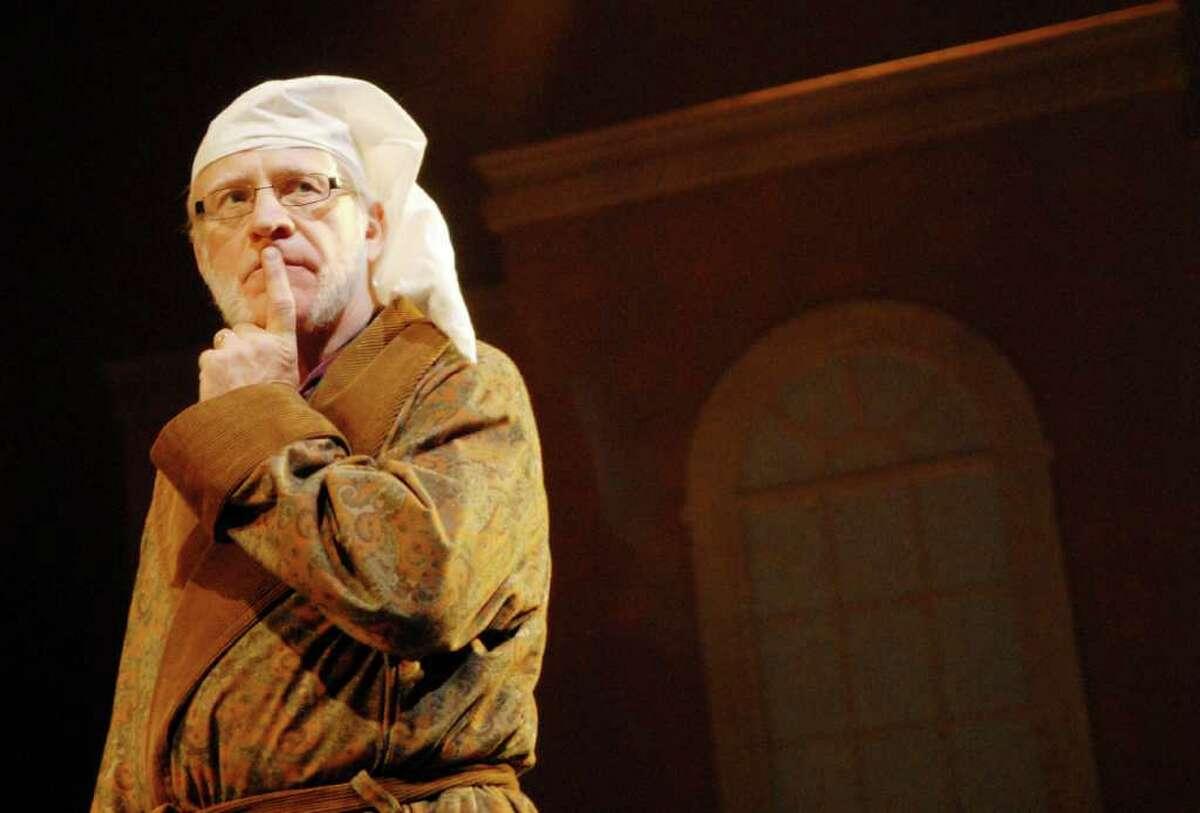 Actor Ron Komora, of Nassau, who stars as Ebenezer Scrooge, performs during rehearsal of