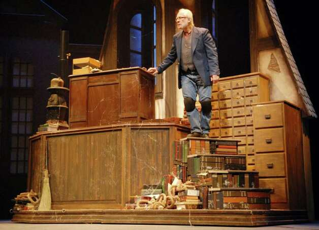 "Actor Ron Komora of Nassau stars as ""Scrooge"" in the counting house during rehearsal of ""A Christmas Carol"", in the theatre at Schacht Fine Arts Center, on the Russell Sage College Campus in Troy, NY, on Tuesday, Nov. 29, 2010, in Troy, NY.  NYS Theatre Institute is currently in rehearsal for ""A Christmas Carol"", that opens Sunday, Dec. 5th.  Without funding this maybe the Institute's final production.      (Luanne M. Ferris / Times Union ) Photo: Luanne M. Ferris"