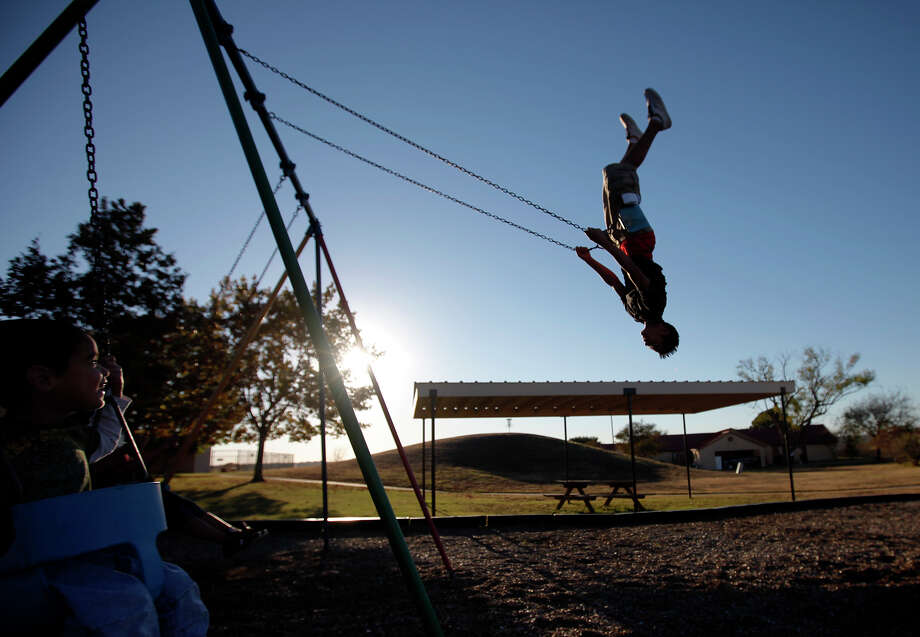 Children play on the swings at Boysville. The home, which opened in San Antonio in 1943 as a haven for homeless boys, also has taken in girls since 1986. Recently, it's been forced to turn away some children. Photo: Kin Man Hui/kmhui@express-news.net