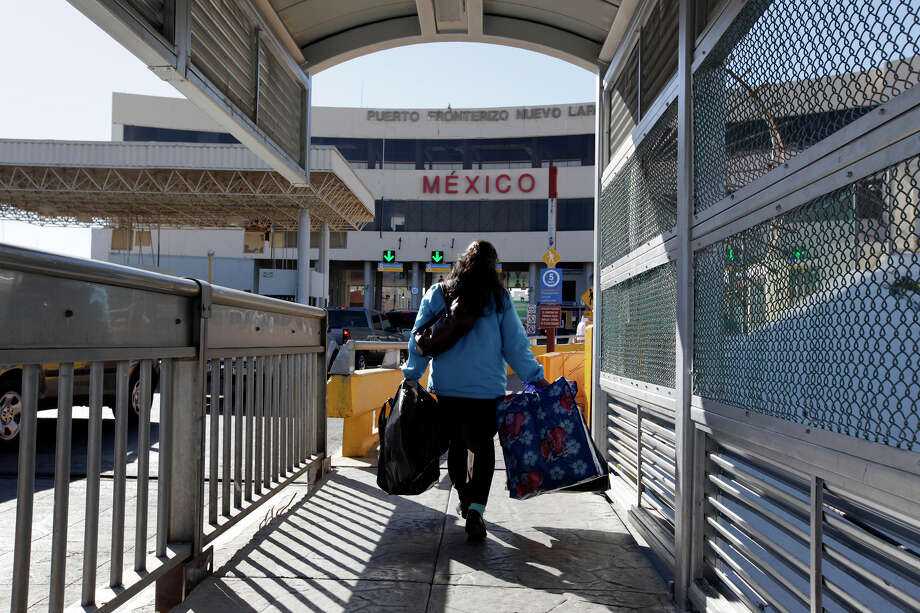 A pedestrian crosses International Bridge No. 1 from Laredo to Nuevo Laredo, Mexico. This once was a popular tourist crossing to shop and party in Nuevo Laredo. But with the Zetas drug cartel looming large in the Mexican city, tourism has dried up. Photo: Jerry Lara/glara@express-news.net