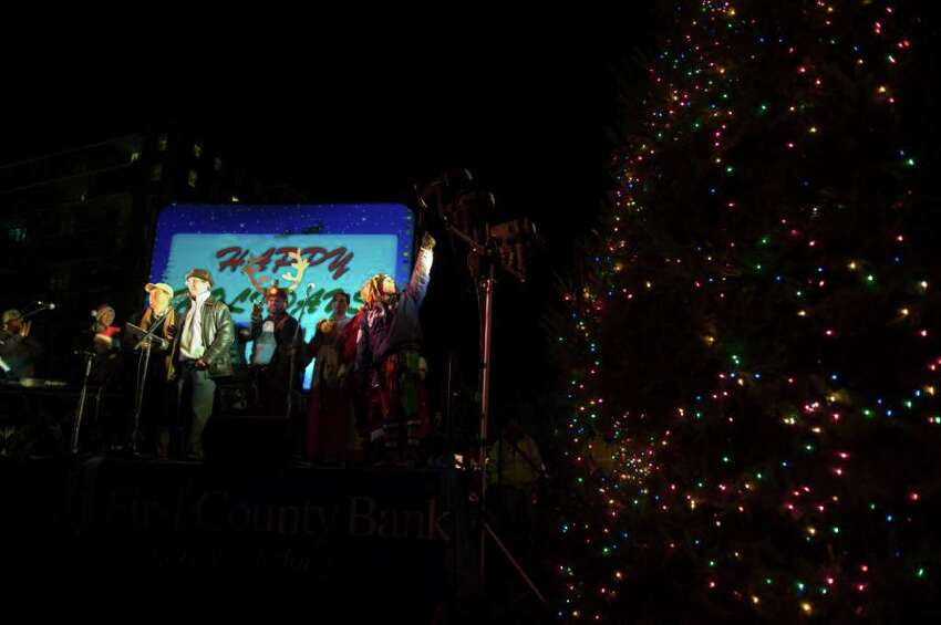 The Heights & Lights ceremony in Stamford Downtown when Santa and his friends rappel down the Landmark Building before lighting the tree in Latham Park in Stamford, Conn., Sunday, December 5, 2010. Cashman served as a repelling elf at this year's event.