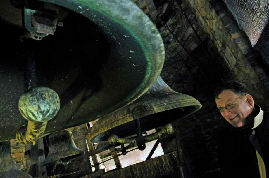 Volunteer George Neary showing the newly cleaned and restored Meneely bells in the tower of St. Joseph's Church in Albany. Volunteer Neary did the dirty work.12/02/2010. ( Michael P. Farrell/Times Union ) Photo: Michael P. Farrell