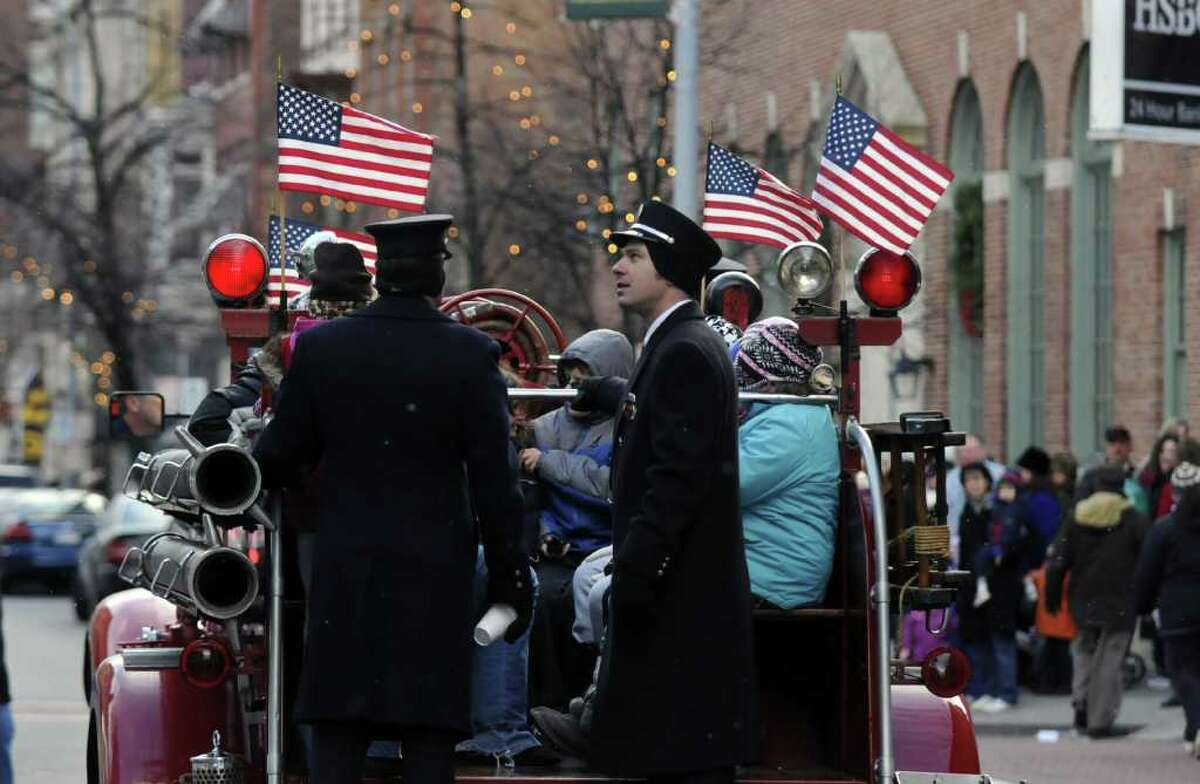 Troy professional firefighters give rides on an antique fire truck during the 28th annual Victorian Stroll in Troy, NY on Sunday December 5, 2010. ( Philip Kamrass / Times Union )