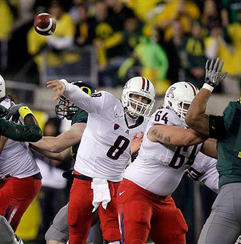 Arizona quarterback Nick Foles (8) throws a pass against Oregon on Nov. 26, 2010.