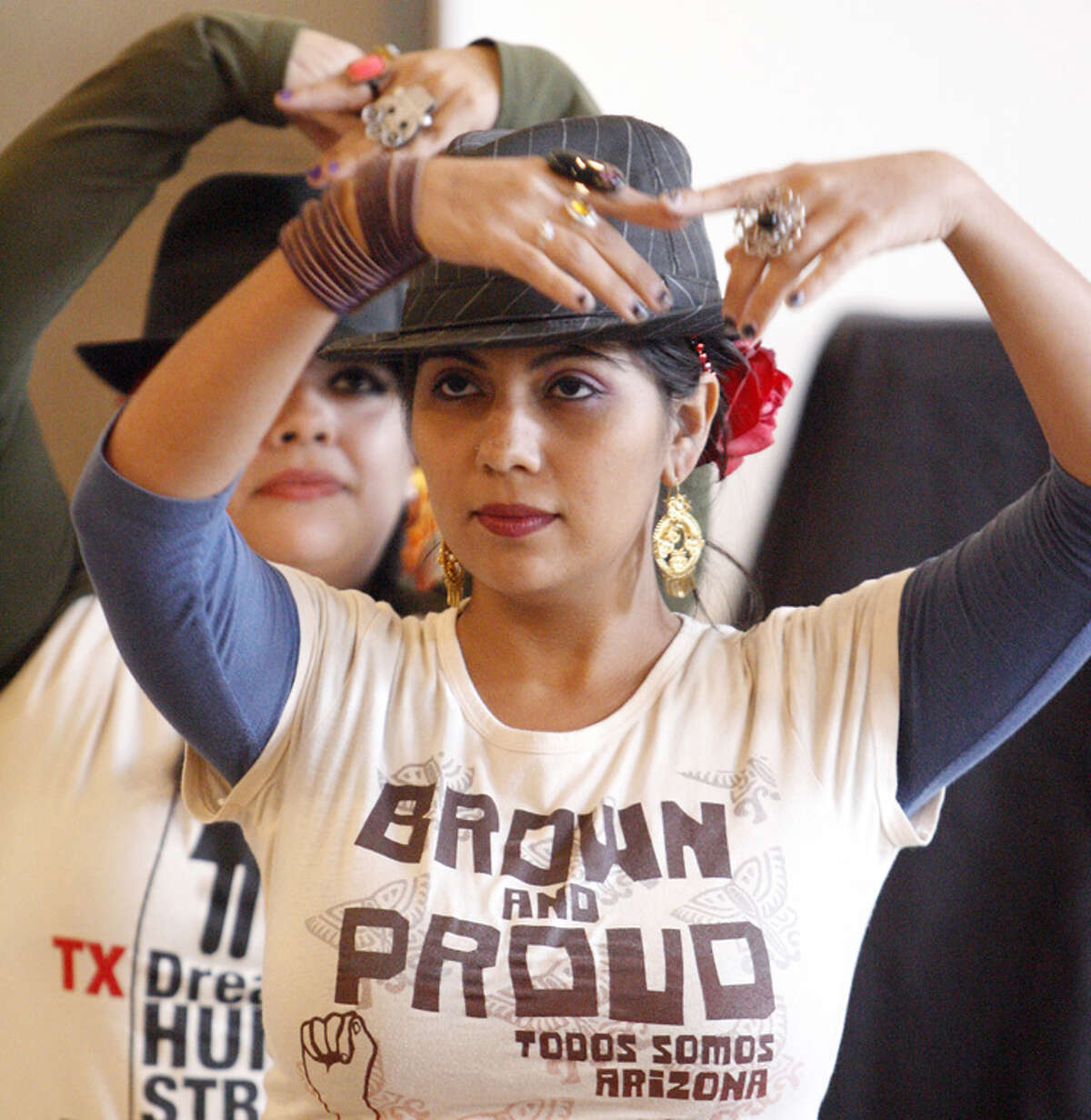 Marisa Gonzalez (front) and Giomara Bazaldua perform an ethnic dance in support of the DREAM Act.