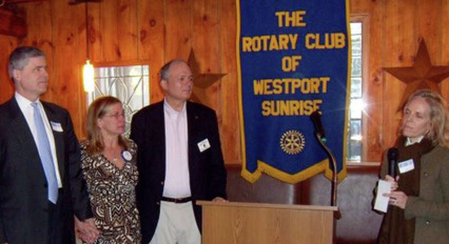 Westport Sunrise Rotary has donated $10,000 in the name of the late Cameron Bruce to the Staples Tuition Grants. Bruce died in September in an accident at his college in Canada. At the presentation of the donation are, from left, Iain and Linda Bruce, the parents of Cameron; Charles Haberstroh, president of Westport Sunrise Rotary's 21st Century Foundation, and Anne Hardy, director of Staples Tuition Grants. Photo: Contributed Photo / Westport News contributed
