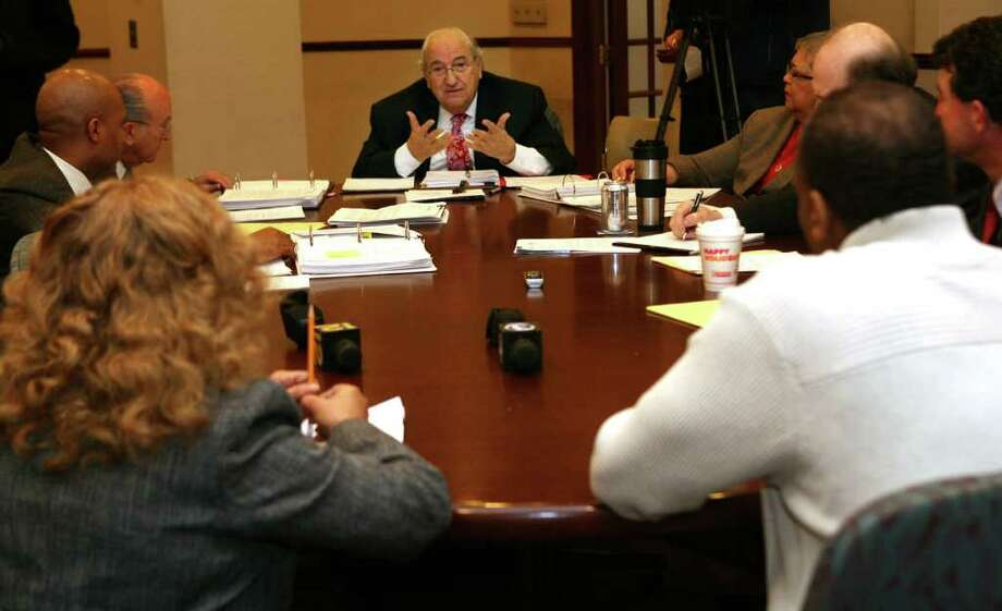 Chair Nick Panuzio, center, poses questions to registrars, Sandi Ayala, left, and Joseph Borges, right, during a panel discussion in Bridgeport City Hall Annex on Monday, December 6, 2010. Photo: B.K. Angeletti / Connecticut Post