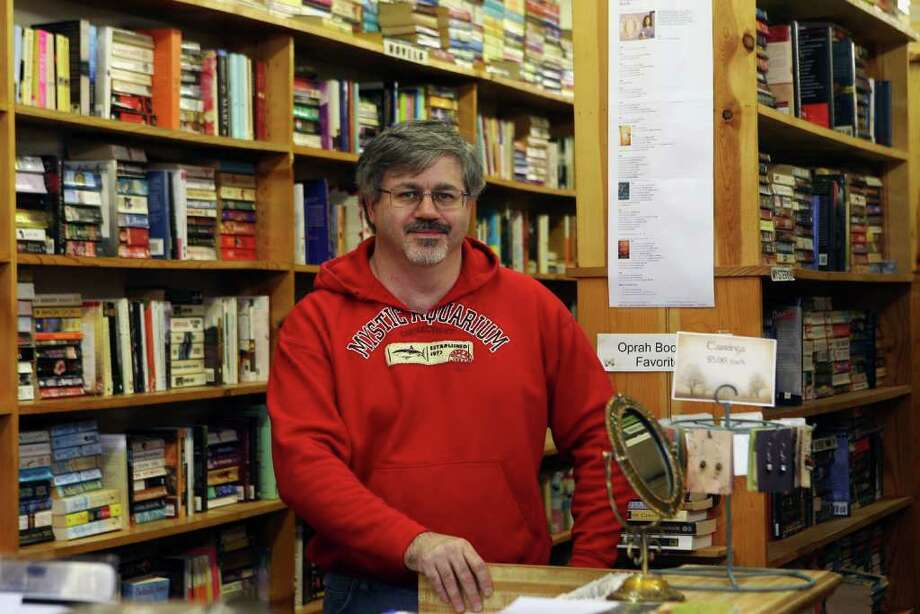 Peter Conway purchased the former The Book Shop, a used book store,  in Monroe and renamed it Tattered Pages Book Shop. Conway also sells jewelery crafted by his wife Diane. Photo: B.K. Angeletti / Connecticut Post