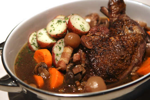 "Coq au vin (kohk-oh-VAHN): Very simply, it means chicken cooked in wine. Audio: Click here to hear the term ""Coq au vin."""