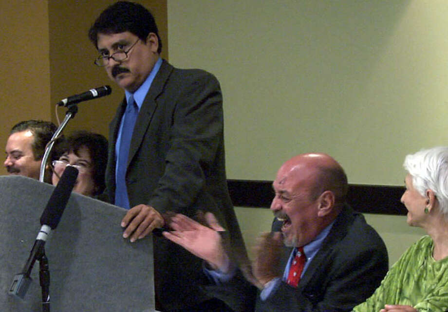"Carlos Guerra, longtime San Antonio Express-News columnist, was ""roasted"" by friends and colleagues on the occasion of his 60th birthday in an event sponsored by the Greater Edwards Aquifer Alliance on June 28, 2007. Here, Victor Landa, emcee for the event, tells a joke about Guerra, right. Photo by Billy Calzada/gcalzada@express-news.net"