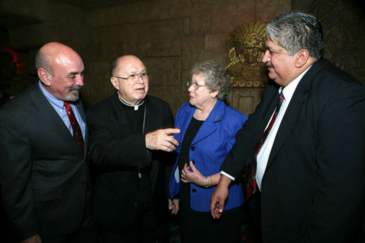 Carlos Guerra, Archbishop Patrick Flores, Sister Charlene Wedelich CDP and Hector Galan were at the Aztec on the River Theater on October 6, 2007 for the screening of the film about Flores. Photo special to the Express-News