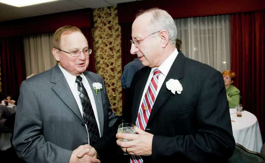 Honorees Lou Filippetti, left, and Frank Iazzi chat as the Stamford Old Timers holds its 68th annual dinner at the Italian Center in Stamford, Conn., Monday, December 6, 2010. Proceeds help fund scholarships for local Scholar-Athletes and sponsorship to area sports teams.