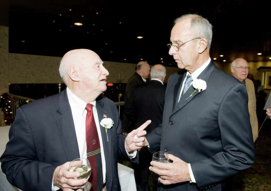 Herb Kohn, left, chats with honoree Ed Lane as the Stamford Old Timers holds its 68th annual dinner at the Italian Center in Stamford, Conn., Monday, December 6, 2010. Proceeds help fund scholarships for local Scholar-Athletes and sponsorship to area sports teams. Photo: Keelin Daly / Greenwich Time