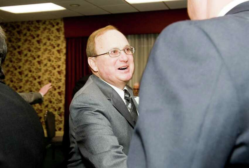 Honoree Lou Filippetti greets a friend as the Stamford Old Timers holds its 68th annual dinner at the Italian Center in Stamford, Conn., Monday, December 6, 2010. Proceeds help fund scholarships for local Scholar-Athletes and sponsorship to area sports teams.