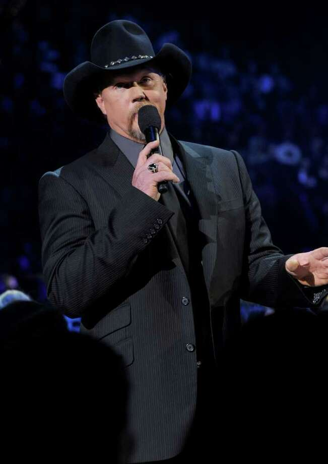 LAS VEGAS, NV - DECEMBER 06:  Host Trace Adkins speaks onstage during the American Country Awards 2010 held at the MGM Grand Garden Arena on December 6, 2010 in Las Vegas, Nevada.  (Photo by Kevin Winter/Getty Images) Photo: Kevin Winter, Getty Images / 2010 Getty Images
