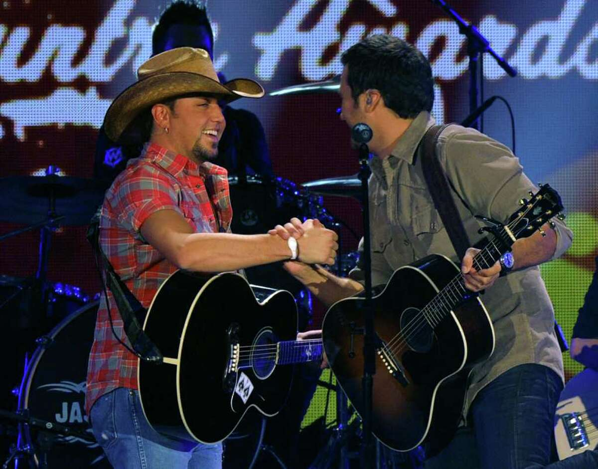 LAS VEGAS, NV - DECEMBER 06: Musicians Jason Aldean (L) and Luke Bryan perform onstage during the American Country Awards 2010 held at the MGM Grand Garden Arena on December 6, 2010 in Las Vegas, Nevada. (Photo by Kevin Winter/Getty Images)