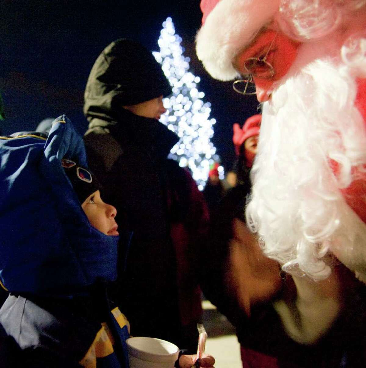 Malaki Benotmane, 4, chats with Santa Claus as Building and Land Technology, the developer of Harbor Point, hosts a tree-lighting ceremony for the first time in Commons Park, a public space newly built as part of Harbor Point in Stamford, Conn., Monday, December 6, 2010.