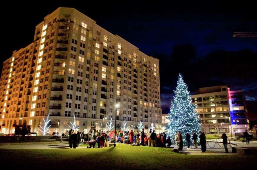 A tree lights Commons Park for the first time as Building and Land Technology, the developer of Harbor Point, hosts the event in Stamford, Conn., Monday, December 6, 2010.