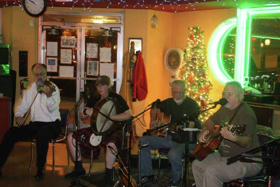 Ron Wilson (from left), Erika Wert, Tom McMasters and Rod Campbell jam Celtic style at the Olmos Bharmacy.