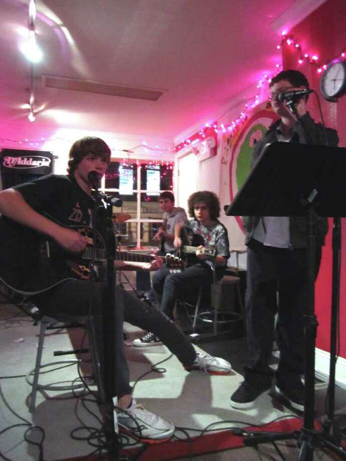 Guitarist/vocalist Tim Dutter, 15, of Fairfield; and bassist Chris Engongoro, 14; guitarist Jeremy Staffa, 15; vocalist Keanan Pucci, 12; and drummer Justin Slosberg (back), all of Westport, rehearse during a Monday performance session at the School of Rock in Fairfield. Photo: Contributed Photo / Connecticut Post Contributed