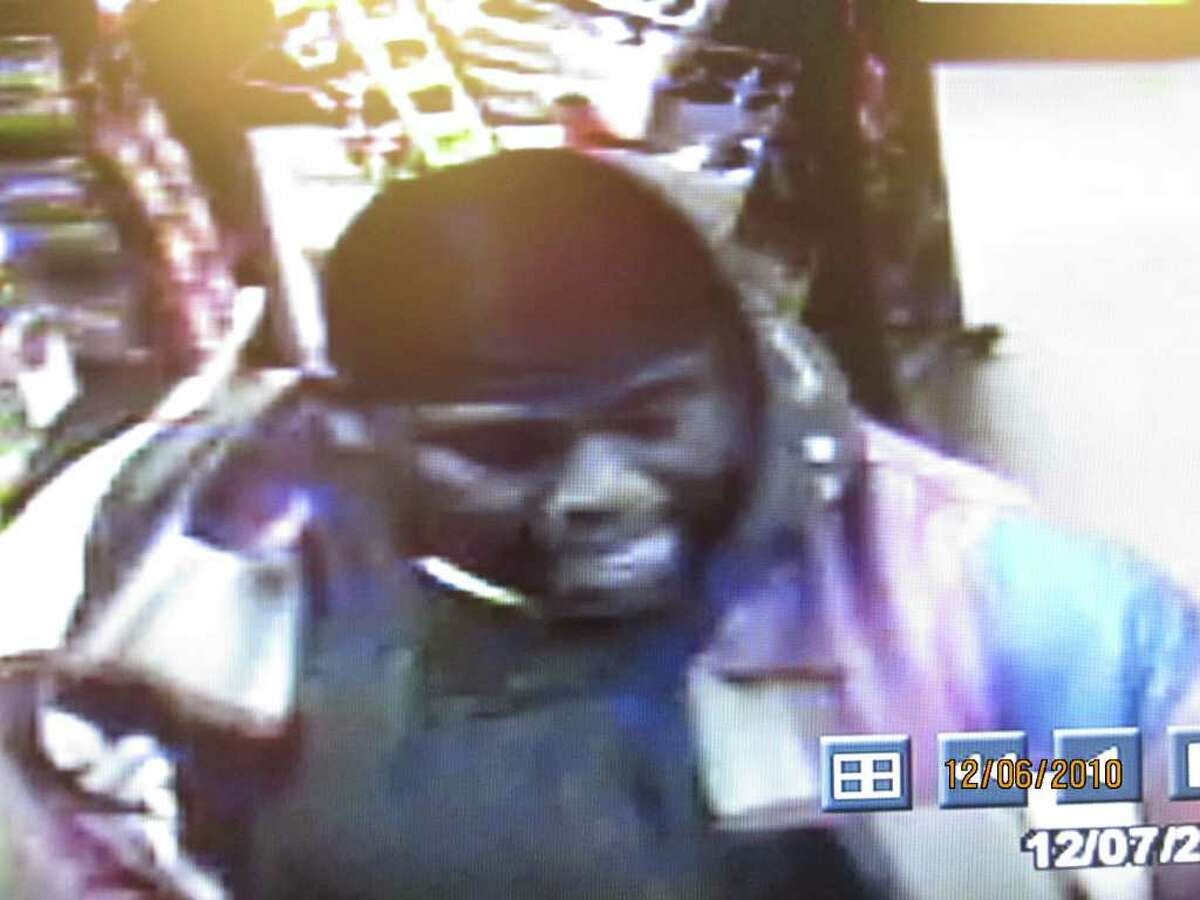 A surveillance video image of one of two men suspected in an armed robbery of a West Side grocery store late Monday night.