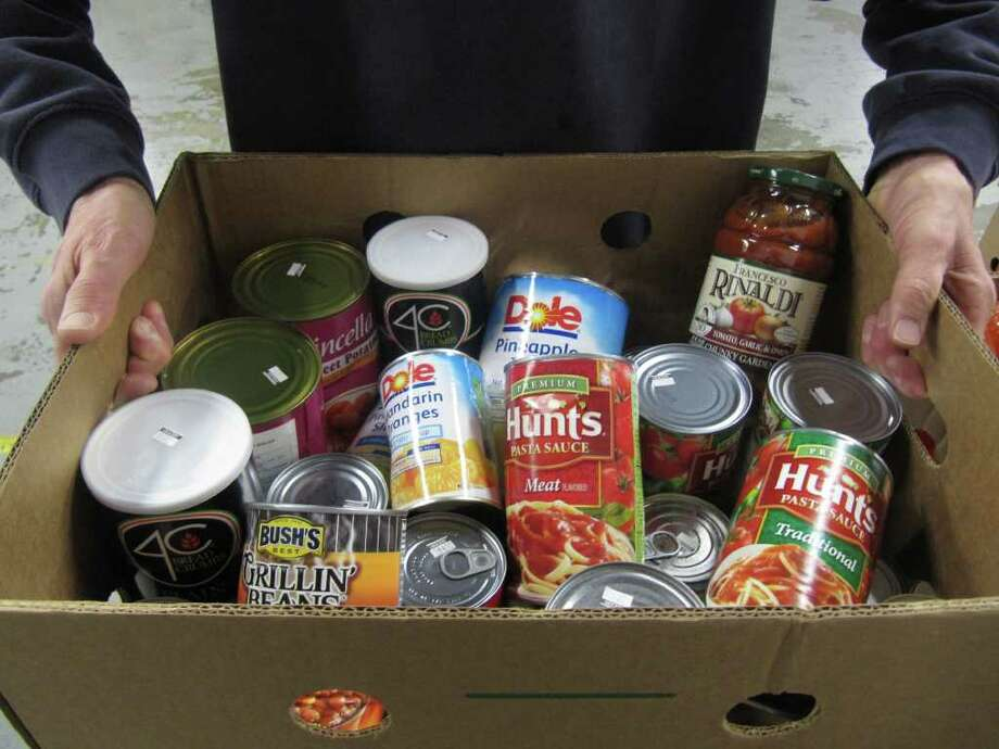 This photo, taken at the  Connecticut Food Bank's Fairfield warehouse on Tuesday, is one of the many agencies in the area that needs donations this time of year. Others in need include Westport's Gillespie Center and Fairfield's Operation Hope. Photo: Kirk Lang / Fairfield Citizen