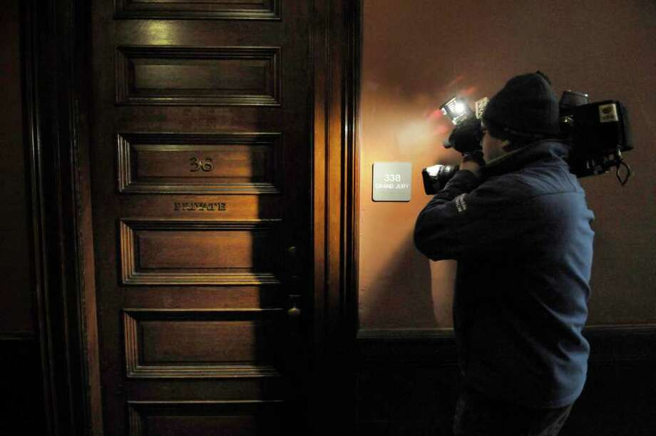 A television cameraman shoots the plaque on the wall for the grand jury room  at the Rensselaer County Court House in Troy on Tuesday, Dec. 7, 2010 as the Rensselaer County grand jury began hearing from witnesses in the ballot fraud investigation. (Paul Buckowski / Times Union) Photo: Paul Buckowski / 00011325A