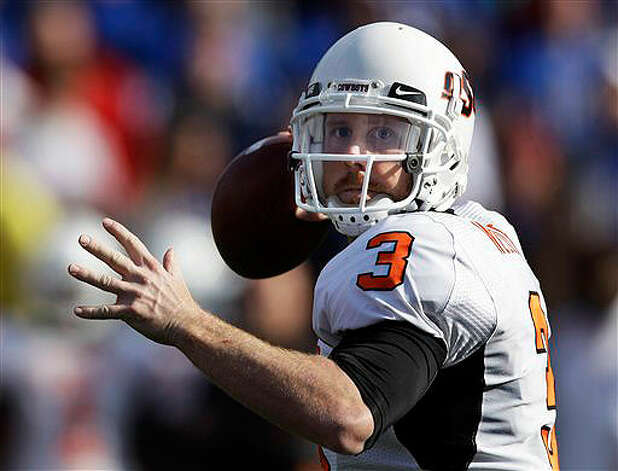 Oklahoma State quarterback Brandon Weeden (3) throws a pass against Kansas on Nov. 20, 2010.